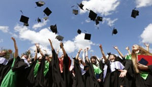 Medical University graduates throw up mortarboards during the celebration of their graduation in Minsk
